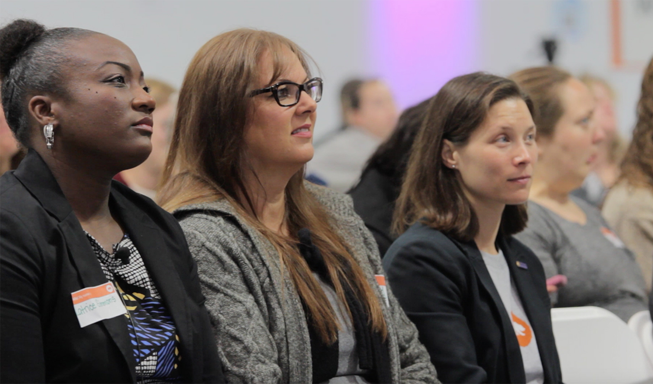 A photo of three California Teachers Summit attendees, Latrice Simmons, Stefania Shaffer and Diana Lujan, seated.