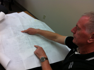 SF State's Chris Bennett uses drawings of Cox Stadium to plan Commencement construction.