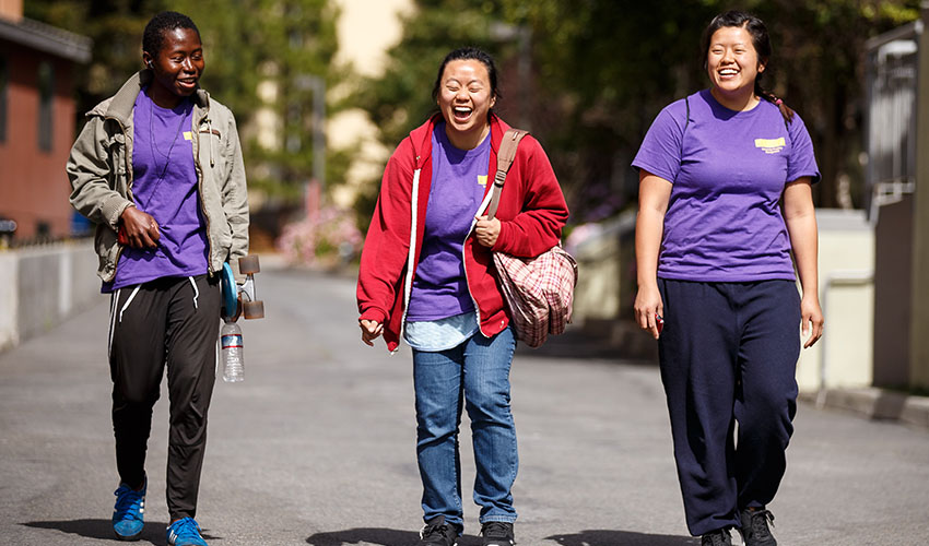 Three SF State students walking on campus