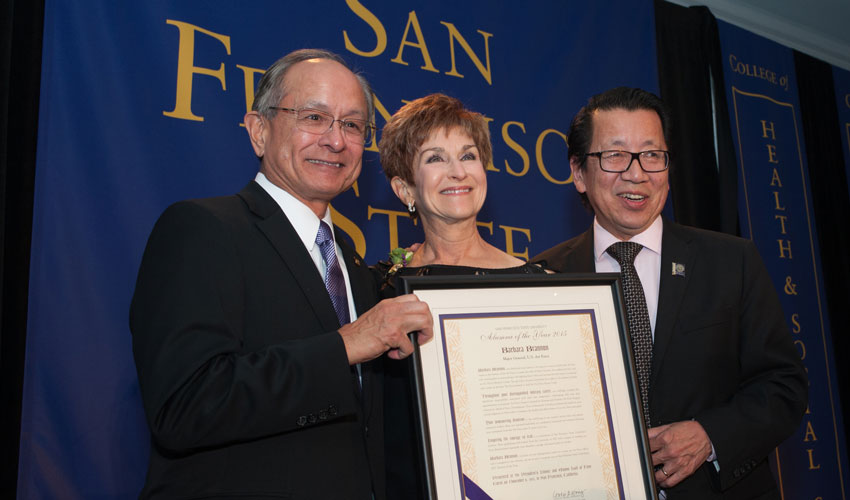President Les Wong and alum Ben Fong-Torres presenting Barbara Lavis Brannon with her 2015 Alumna of the Year award.