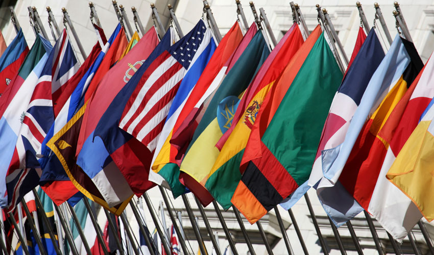 A photo featuring various world flags.