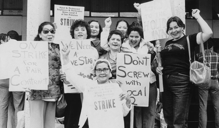 A photo of striking workers holding signs