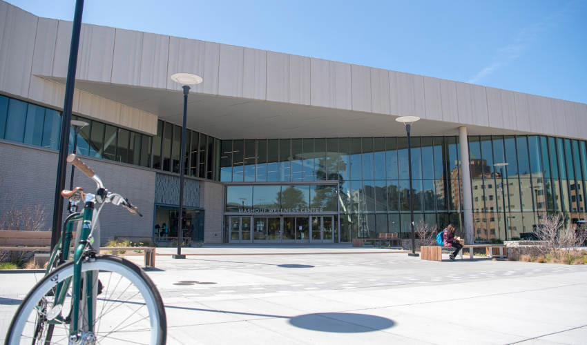 Concrete and glass building with a bicycle in the foreground