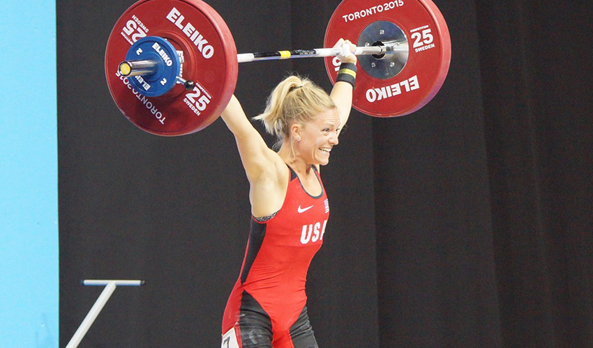 US Olympian Morghan completes a 'clean and jerk' lift.