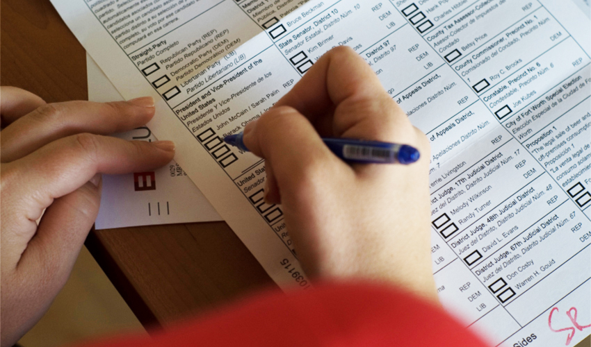 A voter filling out an election ballot.