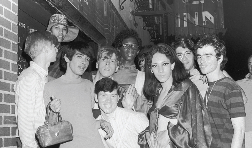Members of the Stonewall riots posing for a picture by the actual Stonewall Inn in 1969.