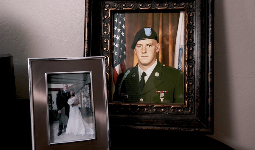 Photo of framed photos of Army Private Benjamin Tollefson