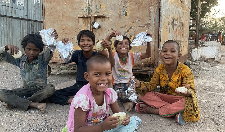 Smiling children with food packets