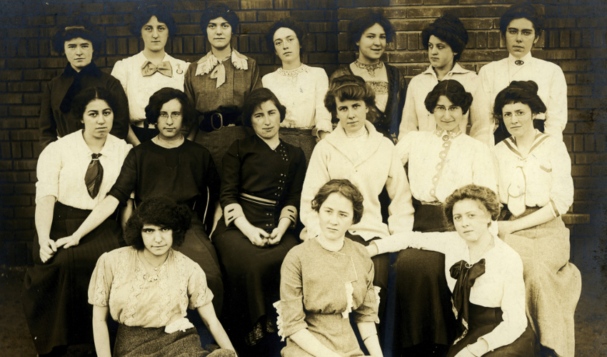 Three rows of female students depicted in a sepia-tone historical photograph