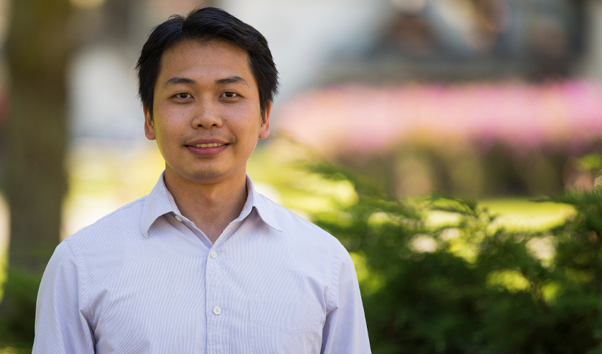 Assistant Professor of Civil Engineering Zhaoshuo Jiang stands outdoors