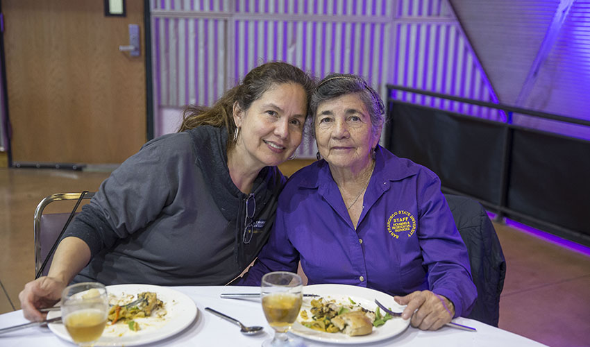 Beatriz Zambrano, who was honored for 20 years of service to SF State, enjoys the recognition luncheon with her daughter, Jhanira Da Silva.