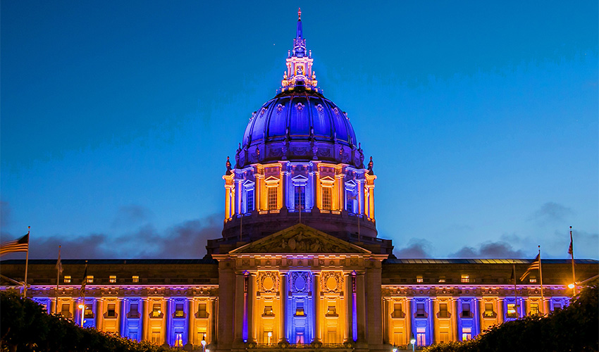 City Hall lit up with Purple and gold lights