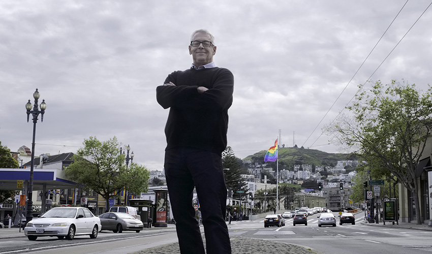 Cleve Jones standing in the Castro