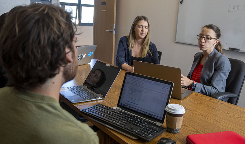 SF State Assistant Professor of English Language and Literature Anastasia Smirnova teaches students in her research lab.