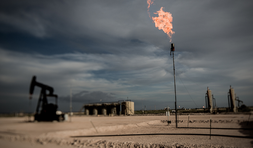Natural gas is flared off from an oil well.
