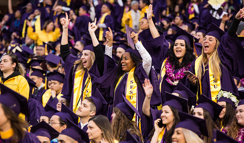 Crowd of SF State graduates cheers during Commencement