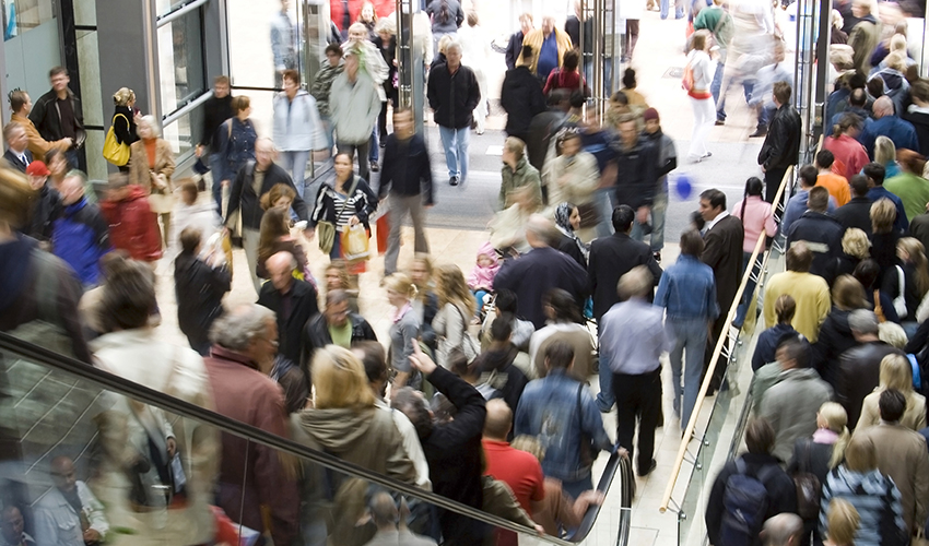 A photo of a crowded shopping mall.