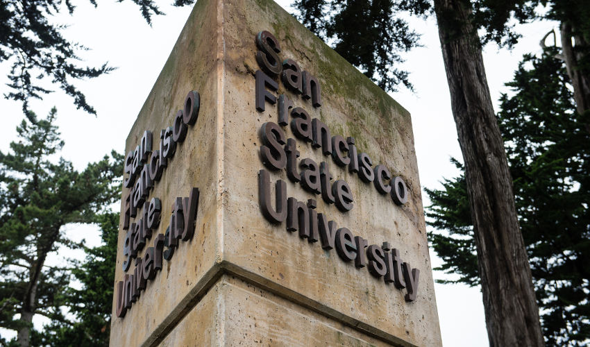 "A concrete sign bearing the words ""San Francisco State University"""