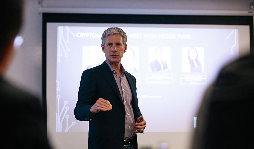 Chris Larsen is talking and gesturing