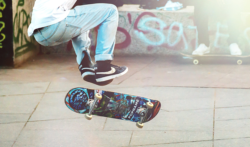 Skateboarder doing a trick in midair.