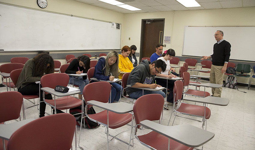 A group of students practices different posture in preparing to take a math test.