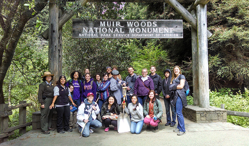San Francisco State Rec, Parks & Tourism students get ready to restore a trail at the entrance to Muir Woods.