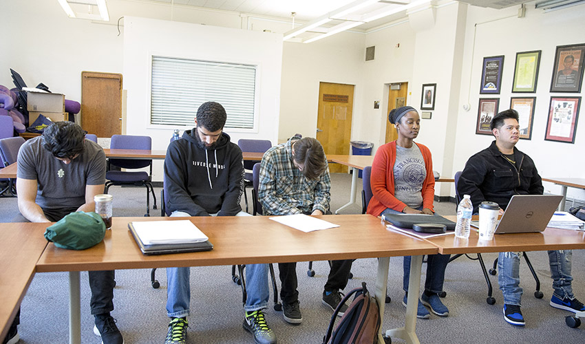 Students conduct a posture experiment.