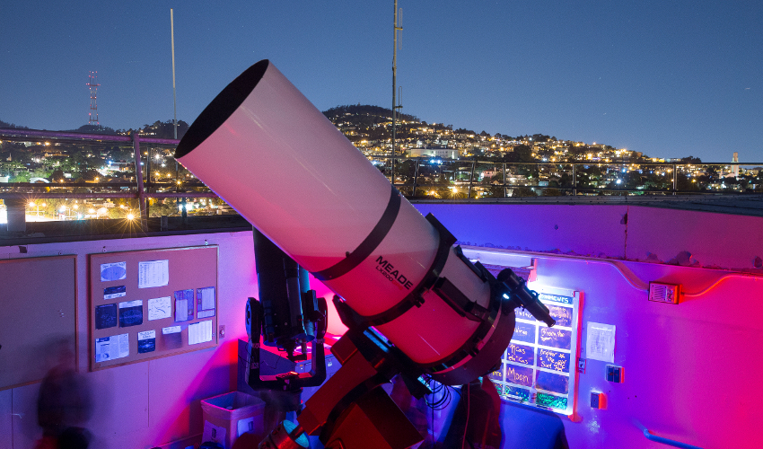 A telescope on the roof of an academic building