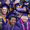 Photo of SF State student in purple caps and gowns