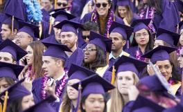 Photo of SF State students in purple gowns at Commencement