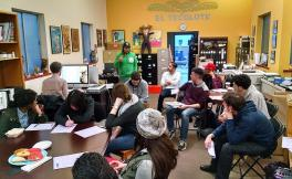 Students meet with an editor in the El Tecolote office