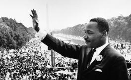 Martin Luther King Jr. waving to a crowd in Washington D.C.'s national mall.