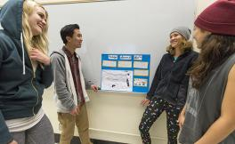 "SF State students, look at a final project for the ""Recreation Destination Resorts"" class inside a classroom in the School of Business on Dec. 8."