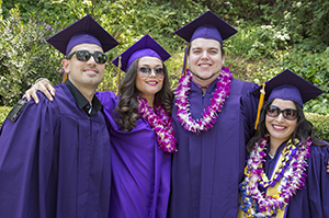 SF State graduates in their purple caps and gowns