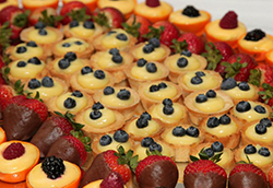 Tarts and chocolate-covered strawberries are arranged on a platter, served at Taste of the Bay 2012