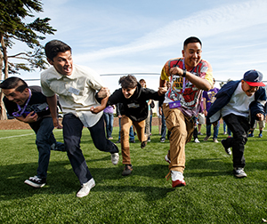 A group of SF State students run in a race.