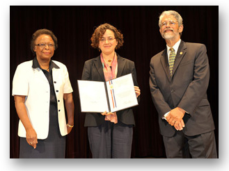 Photo of Mariel Vazquez with Cora Marrett from NSF and John Holdren from the White House Office of Science and Technology Policy.