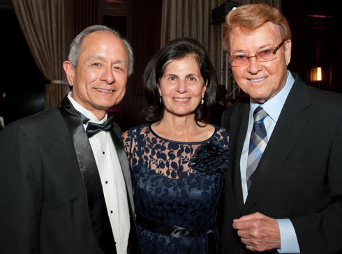 Photo of President Leslie Wong (from left),  his wife, Phyllis Wong, and deaf theatre artist Bernard Bragg, who was inducted into the Alumni Hall of Fame.