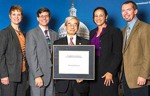 Photo of NAFSA President and Chair of the Board of Directors Meredith McQuaid; Coordinator of Study Abroad David Wick; Associate Vice President of International Education Yenbo Wu; Assistant Director of International Programs Marilyn Jackson; and Martin Simon, son of the late Senator Paul Simon.