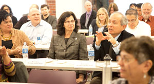 Photo of President Leslie Wong asking a question during the symposium on STEM education.