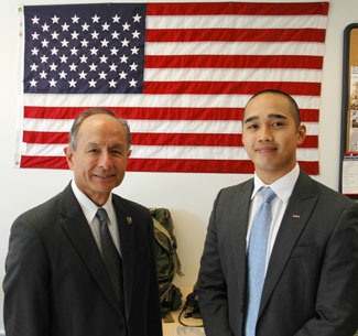 Photo of student John Sonza with University President Les Wong
