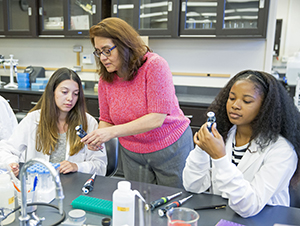 Student Natalie Warren, from left, Professor of Biology Leticia Marquez-Magana and student Joi Lee in the Health Equity Research (HER) Lab at SF State
