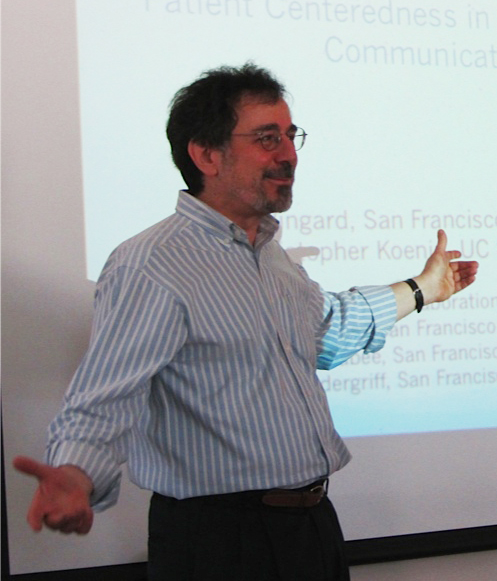 A photo of Professor of English David Olsher giving a presentation.