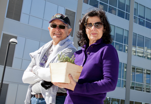 A photo of President and Mrs. Wong outside library, after a day's work planting trees around the J. Paul Leonard library.