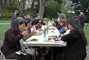 A photo of people eating lunch on the quad during Farm to Fork 2014.