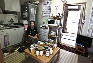 A photo of Fukushima City, Japan resident Tomiyo Fujii in her home.
