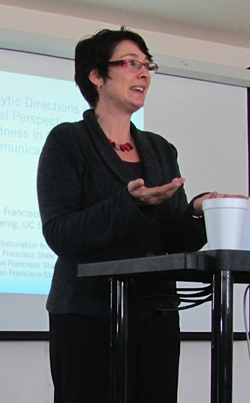 A photo of Associate Professor of Communication Studies Leah Wingard giving a presentation.
