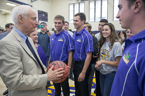 Don Nasser being presented a basketball signed by SF State student athletes.