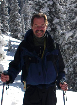 A photo of Professor of Recreation, Parks and Tourism Patrick Tierney while skiing.