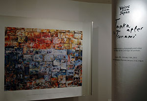 A photo of a collage by Yoshito Sasaguchi featuring a collection of family photos that were damaged by flooding.